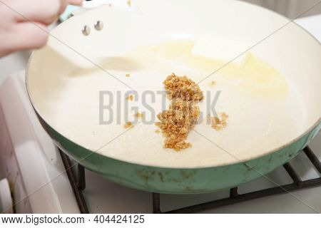 Roasted Minced Garlic And Butter In A Frying Pan