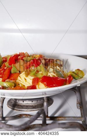 Red And Green Bell Peppers On Cooked Spaghetti