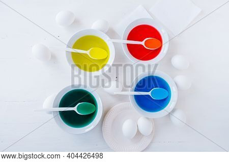 Preparing For Easter. White Eggs With Liquid Food Coloring. Different Colors In Different Bowls, Egd