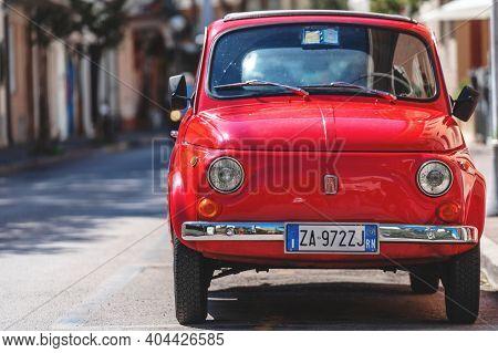 Gabbice Mare, Italy - September 07, 2019. Fiat 500 Classic Retro Car Parked At City Street Road. Ico