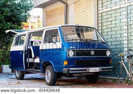 Gabbice Mare, Italy - September 07, 2019. Minibus With Open Doors Parked Near Brick House. Scale Mod