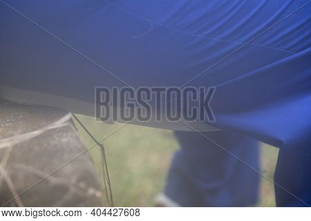 Hazy Image Of Someone Sitting On A Toilet Seat Outside