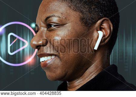 African American woman wearing wireless earbuds