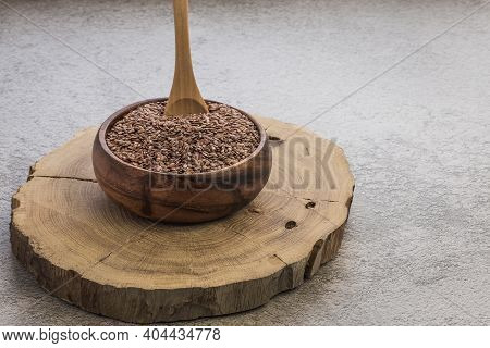 Flax Seeds In A Wooden Bowl On A Concrete Background, A Dietary Cereal Ingredient For Granola That R