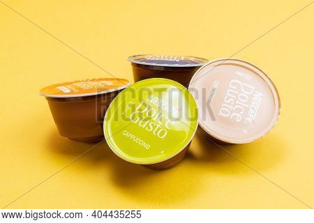 Tyumen, Russia-december 10, 2020: Nescafe Dolce Gusto Different Capsule. Coffee At Home. On A Yellow