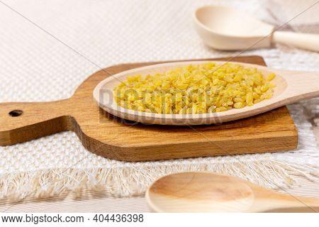 Bulgur In A Wooden Bowl On Wooden Table, Rustic Style. Bulgur Wheat Grains