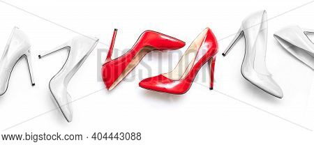 Beautiful Female Shiny Red And White Stilettos On A White Background