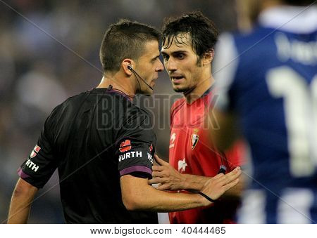 BARCELONA - NOV,10: Alejandro Arribas discussed with the referee Gil Manzano during the a League match between Espanyol and Osasuna at the Estadi Cornella on November 10, 2012 in Barcelona, Spain