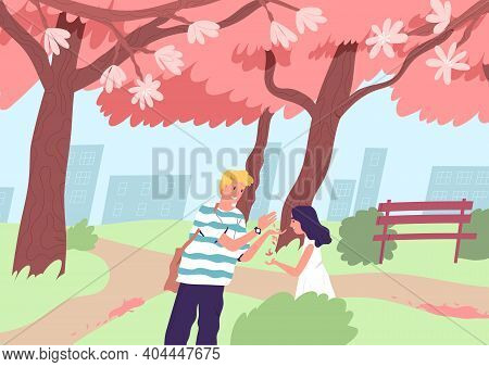 Cute Happy Couple Viewing Cherry Tree Blossom In Spring. Young Man And Woman Walking At City Park Wi