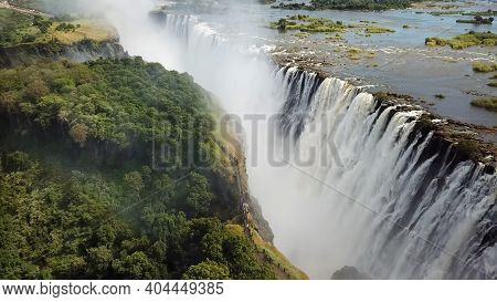 The Victoria Falls At The Border Of Zimbabwe And Zambia In Africa. The Great Victoria Falls One Of T