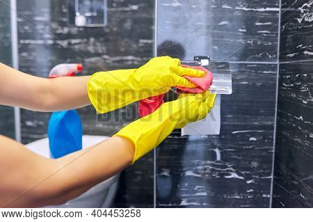 Bathroom Cleaning, Woman In Gloves With Detergent Microfiber Rag Polishing Tiles And Chrome Accessor