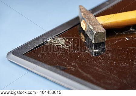 Broken Laptop Screen, Broken Glass With A Hammer On It.
