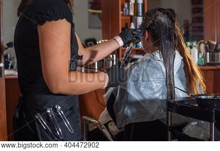 Process Of Hair Colouring In The Hairdress Studio By A Stylist Or Hairdresser