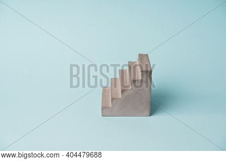 Concrete Starirs Pedestal On Blue Background. Minimal Growth Concept. Copy Space. Stage For Products