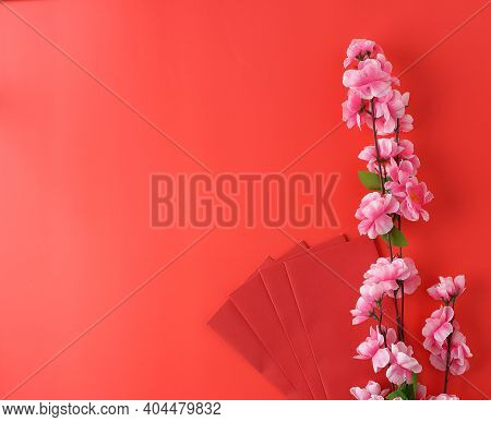 Top View Envelope And Flower On Red Background For Chinese New Year Festival