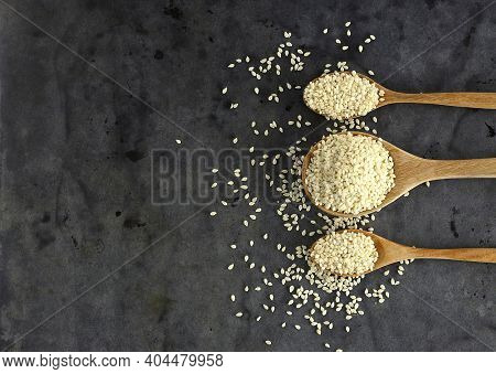 Top View Of Dry Sesame On Black Background