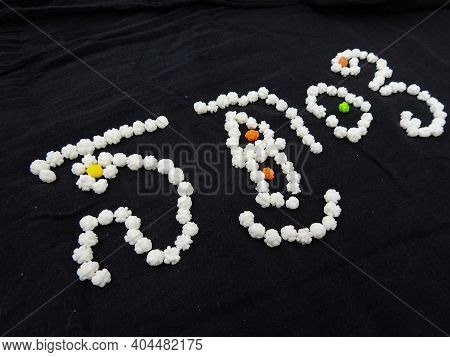 Indian First Festival Sankranti Or Pongal Written In A Kannada Script Using Sugar Coated White Balls