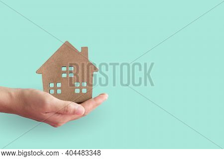 Home Or House Model On Woman Hand In Pastel Color Room Background. Investment Wealthy Freedom Life C