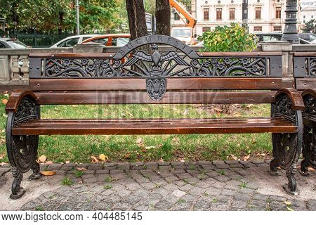 Wooden Bench In The City Park With Word