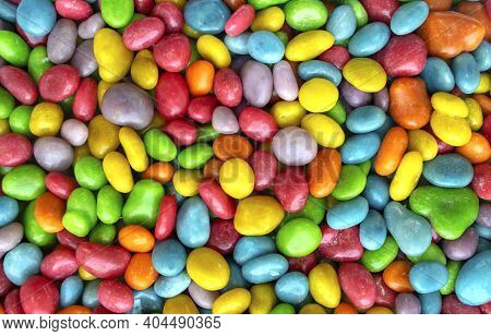 Background Made Of Colorful Candy Dragee, Multi-colodes Glazed Raisins. Seamless Texture Of Multi-co