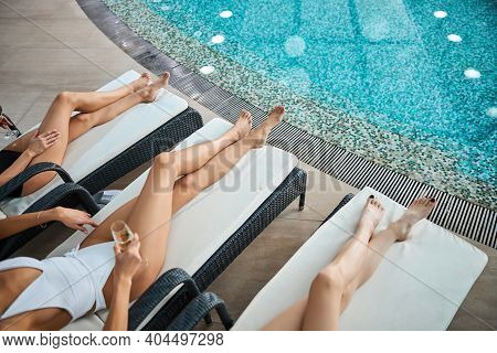 Best Female Friends Having Time By The Pool