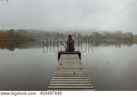 Calm Morning Relaxation By The Foggy Pond. Sitting Woman In The Countryside. Intended Female Mysteri