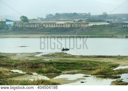 Countryside Landscape, Dprk. Taedong River, Village, Cultivated Shores And Mountains On Background S