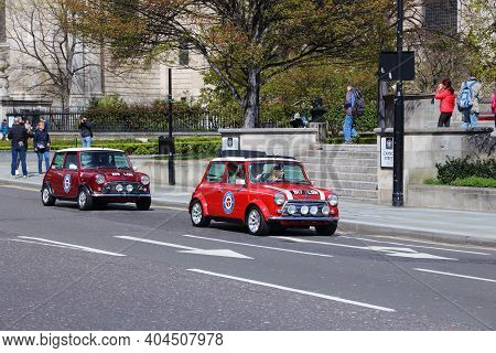 London, Uk - April 23, 2016: Tourists Take Part In Mini Cooper Oldtimer Car City Tour In London. Lon
