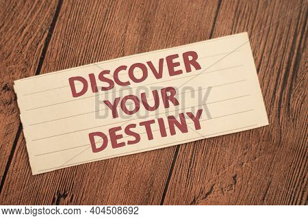 Discover Your Destiny, Text Words Typography Written On Paper Against Wooden Background, Life And Bu
