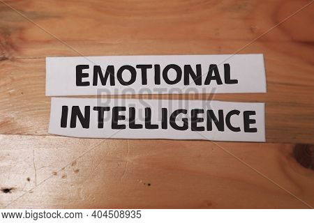 Emotional Intelligence, Text Words Typography Written On Paper Against Wooden Background, Life And B