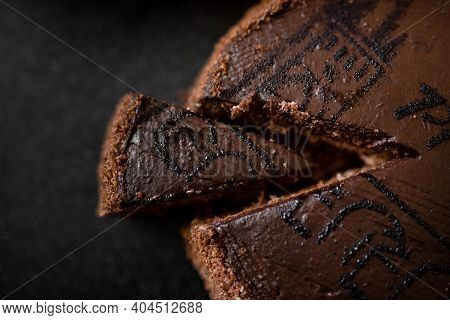 The Isolated Delicious Chocolate Layered Cake With Sponge Cake In The Cut On The Plate, Top View. Ch