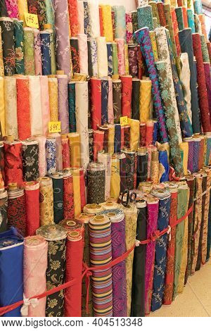Colourful Textile Material In Rolls At Wholesaler
