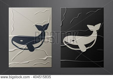 White Whale Icon Isolated On Crumpled Paper Background. Paper Art Style. Vector
