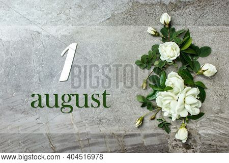 August 1st . Day 1 Of Month, Calendar Date. Stylish Roses Flat Lay. White Roses Border On Pastel Gre