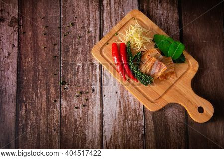 Spices With Ingredients, Stir-fried Spicy And Herb With Dried Fish Fillet On A Cutting Board With Wo