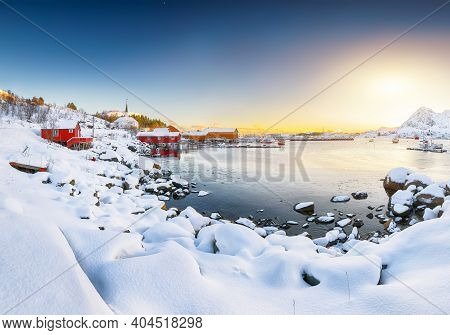 Amazing Winter Scenery Of Moskenes Village With Ferryport And Famous Moskenes Parish Church . Popula
