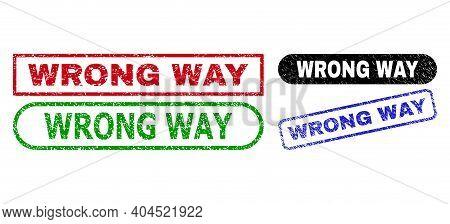 Wrong Way Grunge Seal Stamps. Flat Vector Grunge Seal Stamps With Wrong Way Message Inside Different