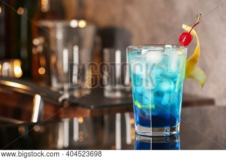 Blue Lagoon Cocktail On Black Table In Bar. Space For Text