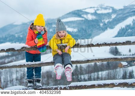Winter Children Friends. Kids Enjoying Nature Wintertime. Winter Child Happy. People In Snow. Theme