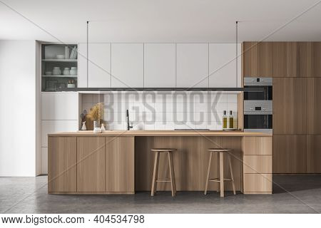 Interior Of Stylish Kitchen With White And Wooden Walls, Concrete Floor, White And Wooden Cupboards