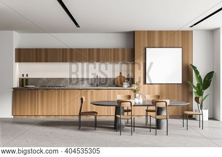 Interior Of Modern Kitchen With Wooden And White Walls, Concrete Floor, Dining Table And Square Mock