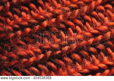 Close-up Of Knitted Cables In A Chunky Knit Red Sweater