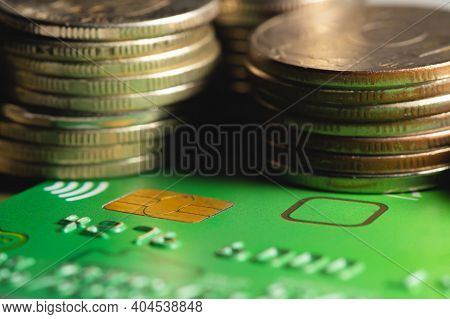 Close-up Shallow Depth Of Field Credit Card With Microchip On The Background Of Columns Of Metallic