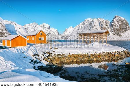Astonishing Winter View Of Sakrisoy Village And Snowy Mountaines On Background. Popular Tourist Dest