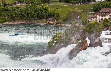 Rhine Falls, Switzerland - May 6, 2017: The Rhine Falls Landscape Photo Taken At Cloudy Spring Day,
