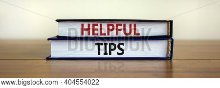 Helpful Tips Symbol. Books With Words 'helpful Tips'. Beautiful Wooden Table, White Background. Busi