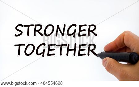Stronger Together Symbol. Businessman Writing 'stronger Together', Isolated On White Background. Bus