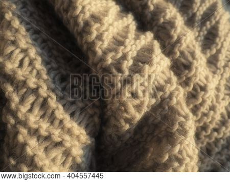 Knitted Product From Bulky Polyacrylic Yarn Of Beige Or Brown Color. Lush Machine Box. Option For A