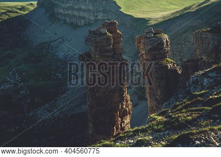 Western Caucasus At Dawn In The Mountains. Two Lonely Rocks At Dawn. View Of The Highest Point In Eu