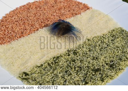 Indian Flag Tri Color Theme Depicted By Natural Colored Rice Grains On Occasion Of Indian Republic D